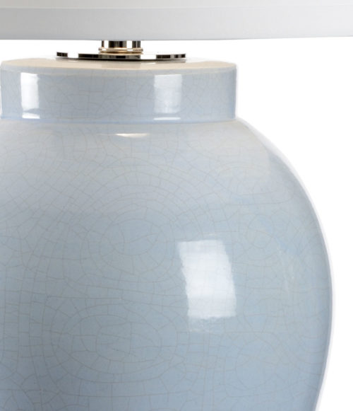 Hand-crafted cloud blue ceramic lamp. This lamp features crackled blue glazed finish and clear acrylic mounting; This coastal living inspired lamp has round silk fabric shade,