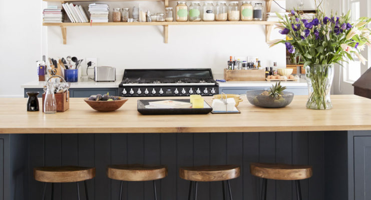 Beautiful cozy kitchen with large kitchen island, lanterns, counter stools and wall shelves on the back; kitchen design ideas; kitchen decor inspiration