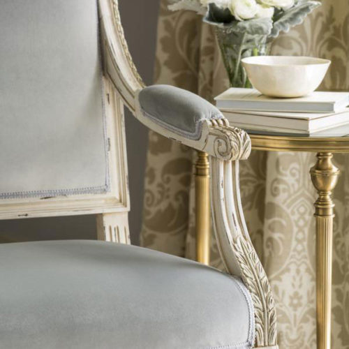 Details of the beautiful Louis XVI upholstered armchair and cast brass table; available at InvitingHome.com