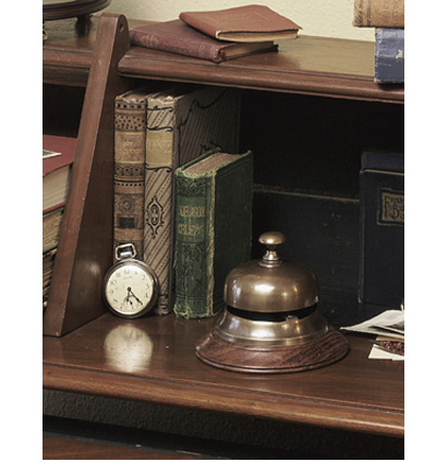 The original desk bell of the Sailor's Inn now comes in duotone bronze. Call the desk agent, request First Class service only. A bell with history.