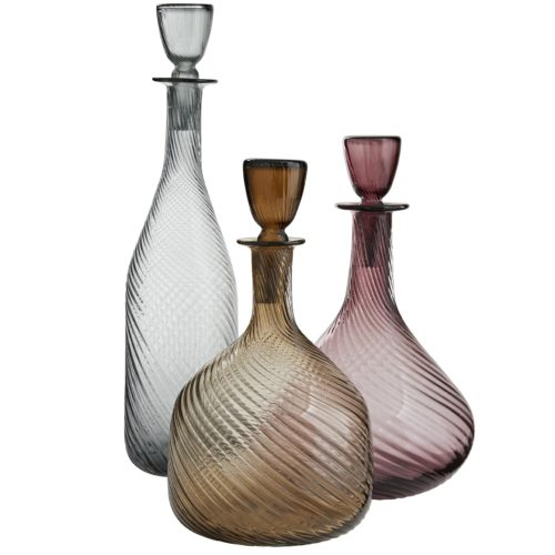 blown with optic glass, which is what gives them an alluring, twisted banding, andthe neutral color palette of amber, smoke and amethyst is a moody take on a range of pastels. Elevate barware or simply display them to establish a bit of sophistication.