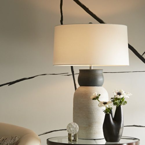 Black and white elegance with this modern table lamp and valve vase.