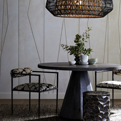 Elegant and sophisticated dining table with natural materials. Modern pedestal style dining table with etched rim adds texture and is eye catching. Unique chandelier in natural rattan with earthy tones.