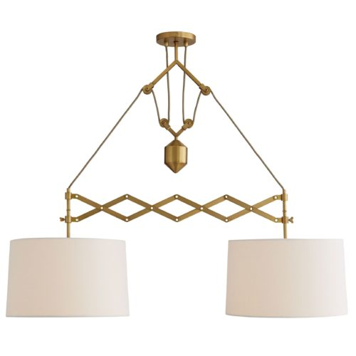 Tension and balance are dynamic qualities this dual pendant light employs. staged over a long dining table or a kitchen island where the linear form of the design can shine. Finished in antique brass.