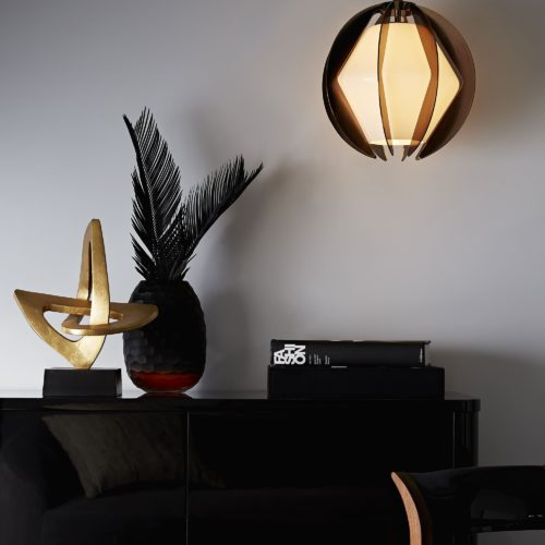 Chic and elegant modern interior with modern oak chest and industrial style pendant.